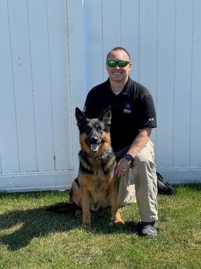 Handler Bradley posing with canine Carter