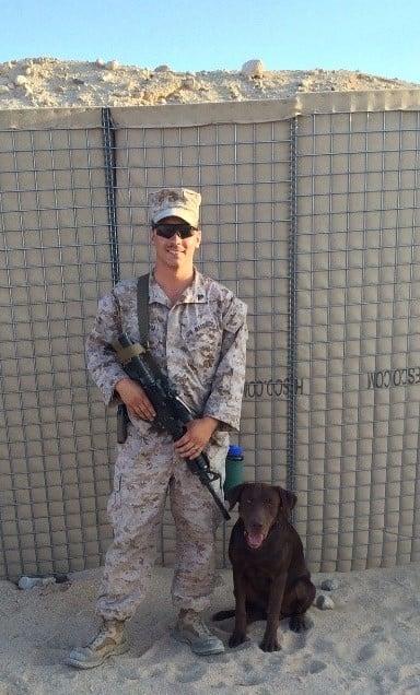 Bradley in Marine uniform with Marine explosive detection canine,Freddie